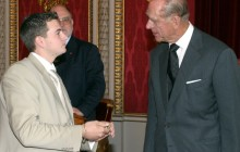 Colin Sanders is presented with his award and congratulated by the Duke of Edinburgh